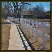 Two rail vinyl fence for accent